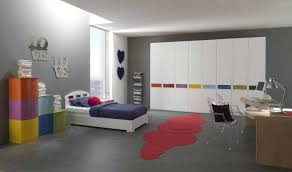 grey wall paint color wooden desk table laminate floor colorful storage white modern bedsheet tall glass