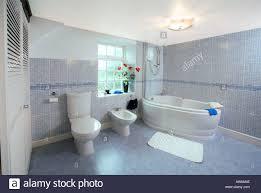 Bathroom Uk Modern Tiled Bathroom Uk With Bath Bidet And Toilet Stock Photo