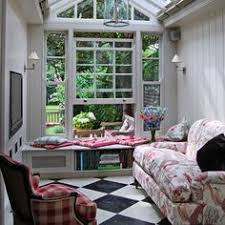 Breaktaking glass conservatory with black hanging chandelier and
