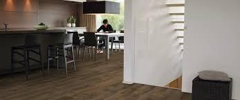 dining room with cambridge oak dark largo wide plank laminate flooring