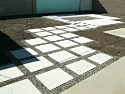 Exterior How To Lay Pavers With Square Pavers And Dark Wood Fence How To Install Pavers In Backyard