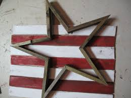 i actually painted way more wood than i needed my first plan was to use the red and white stripes as a background as shown for the star