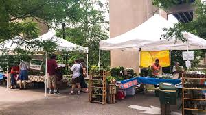 the east falls farmers market uses the same site that will become a beer garden this