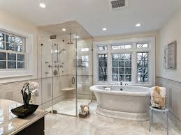 There's something classy and elegant about this master bathroom, which uses  the same flooring for the main area as it does in the walk-in shower.