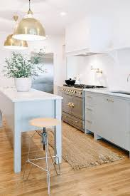 Image Legs Pastel Freestanding Kitchen Cabinets With Brass Touches And Kitchen Island On Tall Legs For Digsdigs 25 Trendy Freestanding Kitchen Cabinet Ideas Digsdigs