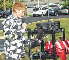 """norwood celebrates veterans day madison press jacob fitzpatrick shares his essay on """"what america means to me"""" during the veterans day celebration at norwood elementary school"""