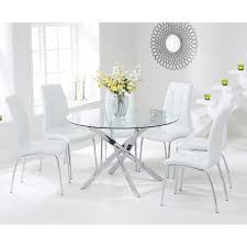 oddess modern round glass dining table with 4 white chairs inside and decorations 3