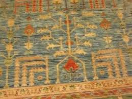 9 x 12 tree of life oriental rug in gorgeous light blue with light green border