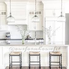 lighting kitchen island. this is exactly what i want ship lap on island white back splash windows at the top of cabinets that go to ceiling marble countertops lighting kitchen