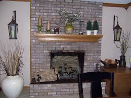 painted brick fireplace with grey paint brick stone fireplace having brown wooden storage near