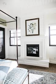 the art i chose to adorn the fireplace ties together the pops of color used in the space the master bathroom
