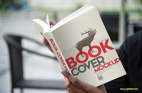 book cover mockup person holding paperback book in hands for showcasing cover design