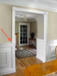 never interrupt the casing with the chair rail or with wainscoting the casing is supposed to resemble a clical column and should run uninterrupted from