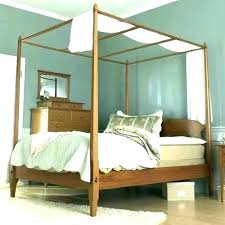 French Canopy Bed With Sheer Curtains Tied To Posts Without – guilded.co