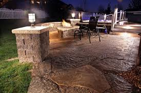 ideas for lighting. Chic Fire Place Made Of Stone Also Led Patio Lighting Ideas With Black Chair For