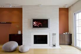 minimalist living room with sleek stacked stone fireplace