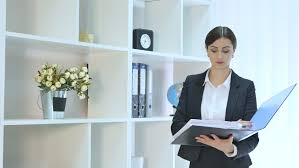 beautiful bright office. beautiful young business woman holding folder in bright office at stock footage video 22780087 shutterstock a