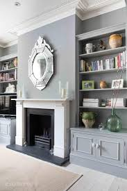 grey living room scheme color bookcase with storage wall unit classic white electric fireplace silver victorian style wall mirror green glass vase