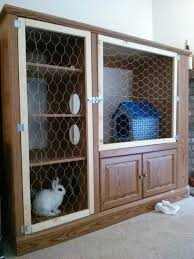 upcycled diy bunny hutch out of an entertainment center