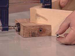 use drill press to drill holes through jig