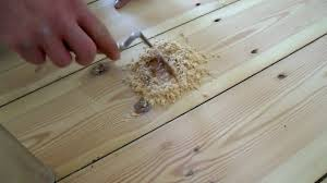 sanding floorboards hammering in nails cleaning gaps filling nail holes you