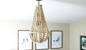 wood bead chandelier i love this chandelier made from wood beads it looks like it wood wood bead chandelier