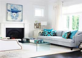 modern furniture living room with grey sofa set and attractive artistic blue cushion motif on white rug