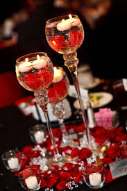 Red Black White Wedding. Center pieces. Candle holders on mirrors with red  roses and