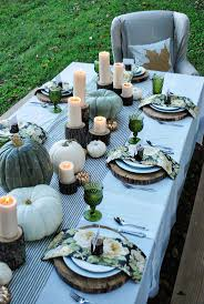Pumpkins, gourds and candles on tree stumps would be a great alternative to  a simple