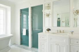 master bathroom with frosted glass his and hers shower doors