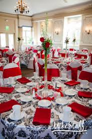 my table is similar to this, i would do a red table cloth and three