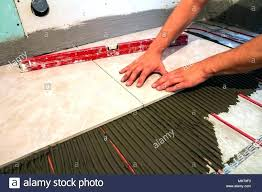 can you install tile over vinyl lay linoleum floor tile over vinyl linoleum floor coverings can you lay in basement wall installing