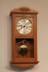 light oak wall clock with winding key in mint condition late 20th century
