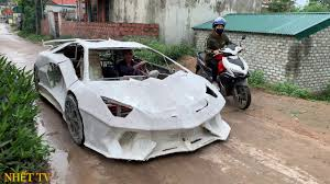 Building a bugatti chiron out of cardboard and duct tape. Lamborghini And Bugatti Supercars Created From Cardboard Autoblog
