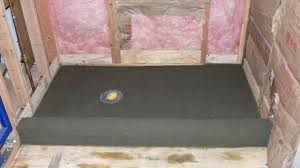 build a shower base shower pan first mud layer sloped 1 4 per foot to drain