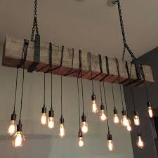 reclaimed wood chandelier a custom barn beam light fixture modern industrial rustic restaurant bar lighting