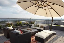rooftop deck furniture. Plain Deck Contemporary Outdoor Furniture Surrounds A Modern Fire Pit Underneath  Large Patio Umbrella On This New York Rooftop Deck Inside Rooftop Deck Furniture U