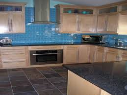 blue subway glass tile backsplash with canopy rangehood on electric cooktop