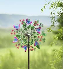 bring color and motion to your yard with wind spinners in all sizes colors and designs get your new wind spinner garden whirligig or garden spinner here