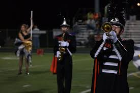 the mhs marching knights perform their half time show at a home varsity football game