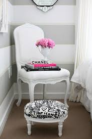 Love the striped wall, the white chair, the pink flowers and Chanel book :)  my future room