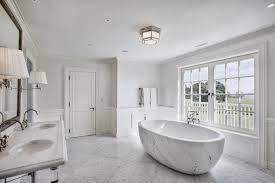 luxury master bathroom. bathroom. lavish stand alone marble bathtub with unique ellipse shaped for luxury master bathroom design