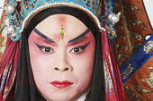 portrait of a male chinese opera performer looking serious