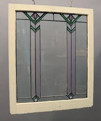 antique window sash features classic arts crafts design in the style of frank lloyd wright