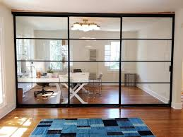 room dividers 3 doors on triple track system with clear glass and black frame