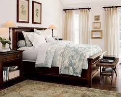 Small Master Bedroom Interior Design Hip Brown Wooden Master Bed Frames Added White Floral Cover Sheet