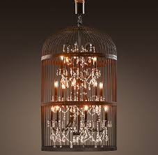 the quality of light produced and the marriage of the vintage style bird cage with the elegant crystal chandler is inspired