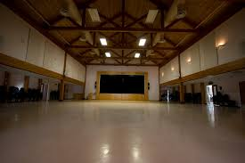 there is a floating hardwood dance floor in front of the se the height from the floor is 44 ft