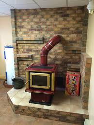 cute wood stove installation with custom stovepipes