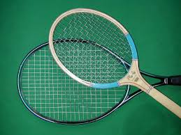 a photo ilrating design differences between old and new tennis rackets